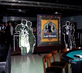 Vintage Vegas Posters flanked by Dancing Couples with Chaser Lights
