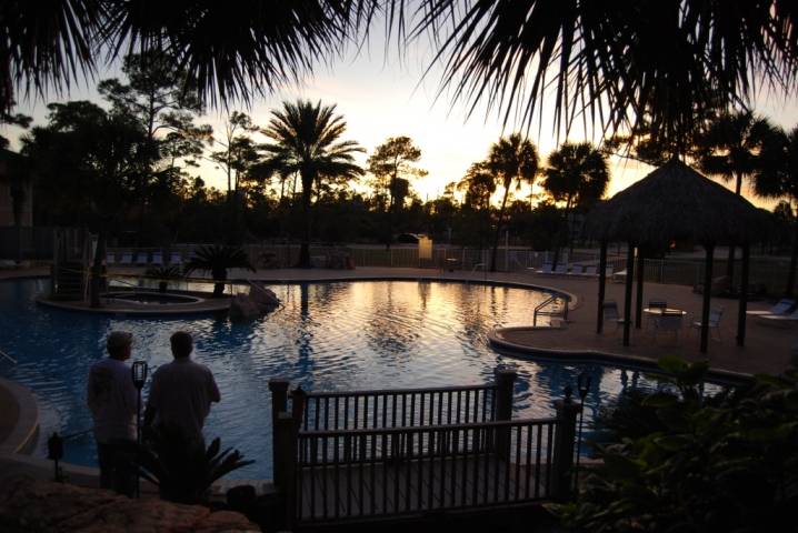 Purple Parrot Resort Outdoor Pool at sunset